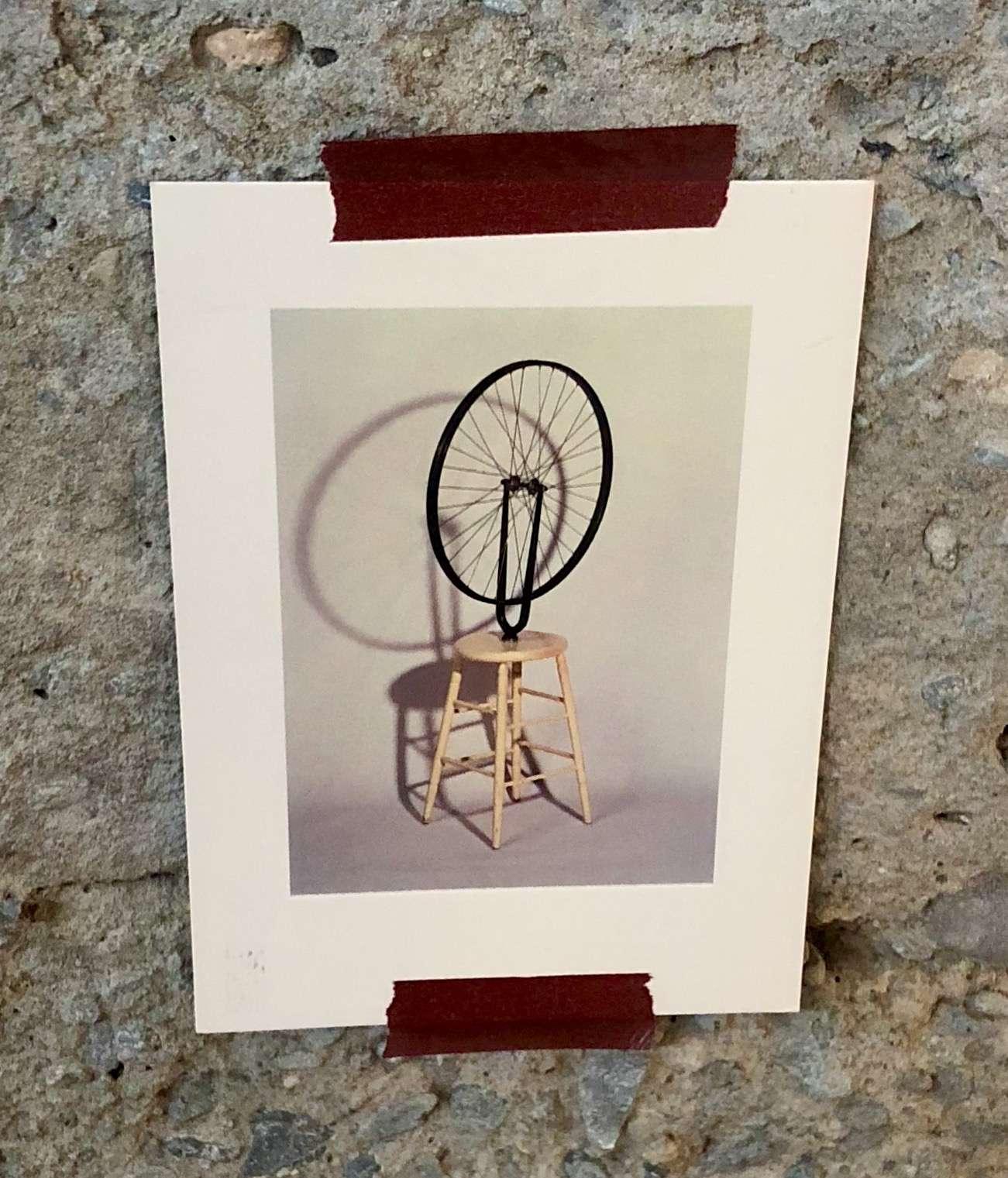 Image of postcard delivered by Sarah Cannon to Notion's office. The postcard, of Marcel Duchamp's 'Bicycle Wheel Sculpture' is reportedly hanging in their office...